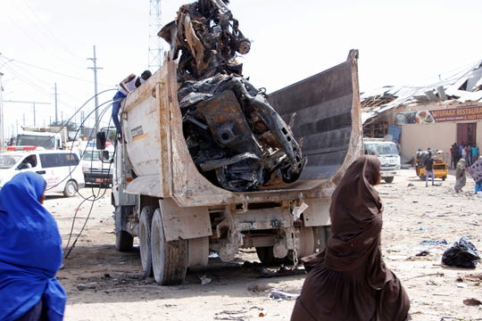 A truck carries wreckage of a car used in a car bomb in Mogadishu, Somalia, Saturday, December 28, 2019.