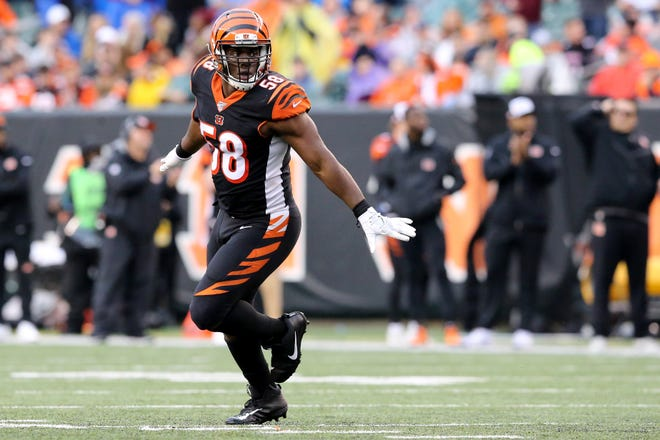 Cincinnati Bengals defensive end Carl Lawson (58) celebrates a sack in the fourth quarter during an NFL Week 17 game against the Cleveland Browns, Sunday, Dec. 29, 2019, at Paul Brown Stadium in Cincinnati. Cincinnati Bengals won 33-23.