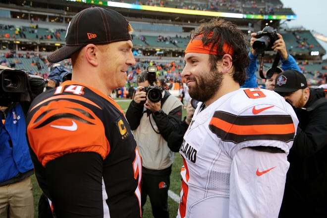 Cincinnati Bengals quarterback Andy Dalton (14) and Cleveland Browns quarterback Baker Mayfield (6) shakes hands at the conclusion of an NFL Week 17 game, Sunday, Dec. 29, 2019, at Paul Brown Stadium in Cincinnati. Cincinnati Bengals won 33-23.