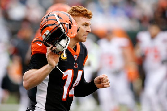 Cincinnati Bengals quarterback Andy Dalton (14) pulls off his helmet as time expires in the second quarter of the NFL Week 17 game between the Cincinnati Bengals and the Cleveland Browns at Paul Brown Stadium in downtown Cincinnati on Sunday, Dec. 29, 2019. The Bengals led 20-16 at halftime.