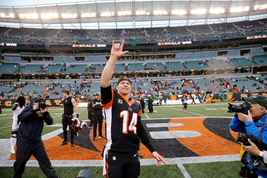 Cincinnati Bengals quarterback Andy Dalton (14) smiles as he heads for the locker room after the fourth quarter of the NFL Week 17 game between the Cincinnati Bengals and the Cleveland Browns at Paul Brown Stadium in downtown Cincinnati on Sunday, Dec. 29, 2019. The Bengals finished their 2019 campaign with a 33-23 win over the Browns.