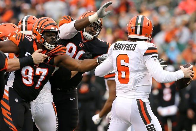 Cincinnati Bengals defensive tackle Geno Atkins (97) and Cincinnati Bengals defensive tackle Andrew Billings (99) apply pressure on Cleveland Browns quarterback Baker Mayfield (6) in the first quarter during an NFL Week 17 game, Sunday, Dec. 29, 2019, at Paul Brown Stadium in Cincinnati.