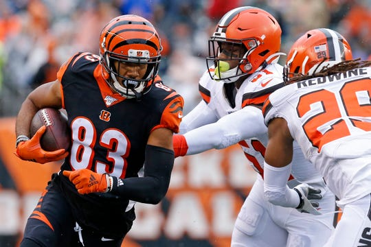 Cincinnati Bengals wide receiver Tyler Boyd (83) runs after a catch in the second quarter of the NFL Week 17 game between the Cincinnati Bengals and the Cleveland Browns at Paul Brown Stadium in downtown Cincinnati on Sunday, Dec. 29, 2019. The Bengals led 20-16 at halftime.