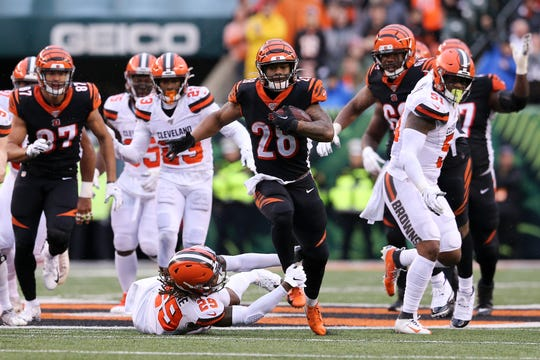 Cincinnati Bengals running back Joe Mixon (28) breaks a tackle by Cleveland Browns defensive back Sheldrick Redwine (29) on a run in the fourth  quarter during an NFL Week 17 game, Sunday, Dec. 29, 2019, at Paul Brown Stadium in Cincinnati. Cincinnati Bengals won 33-23.