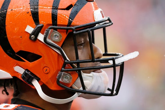 Cincinnati Bengals running back Joe Mixon (28) walks the sideline in the second quarter of the NFL Week 17 game between the Cincinnati Bengals and the Cleveland Browns at Paul Brown Stadium in downtown Cincinnati on Sunday, Dec. 29, 2019. The Bengals led 20-16 at halftime.