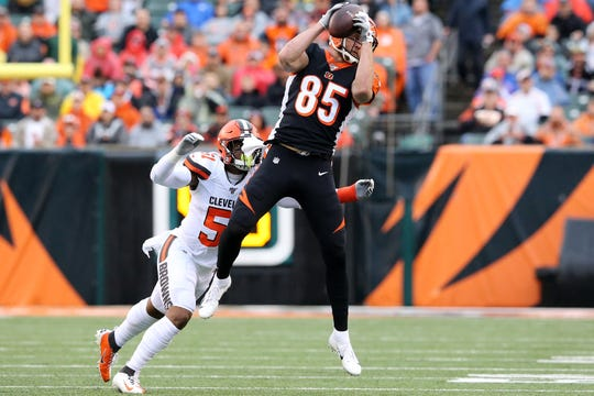 Cincinnati Bengals tight end Tyler Eifert (85) completes a catch as Cleveland Browns linebacker Mack Wilson (51) defends in the first quarter during an NFL Week 17 game, Sunday, Dec. 29, 2019, at Paul Brown Stadium in Cincinnati.
