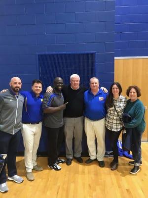 North Brunswick boys basketball coach Ed Breheney (center) won his 400th game on Saturday, Dec. 28, 2019.