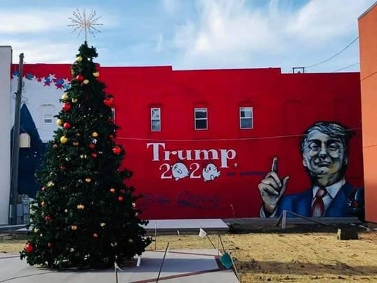 A mural on the side of a privately owned building on the 800 block of Story Street in downtown Boone, Iowa, was stenciled onto the side of the building Dec. 22 and completed two days later.