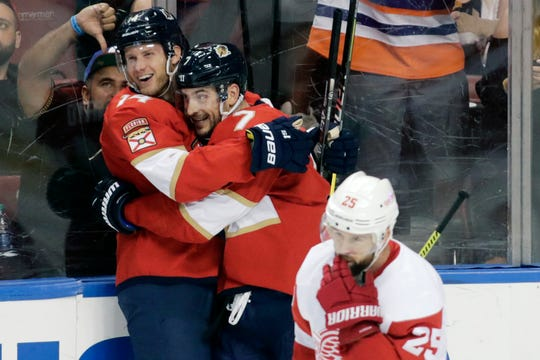 Florida Panthers' Dominic Toninato, left, celebrates with teammate Colton Sceviour, right, after scoring a goal during the second period of an NHL hockey game the against the Detroit Red Wings, Saturday, Dec. 28, 2019, in Sunrise, Fla.