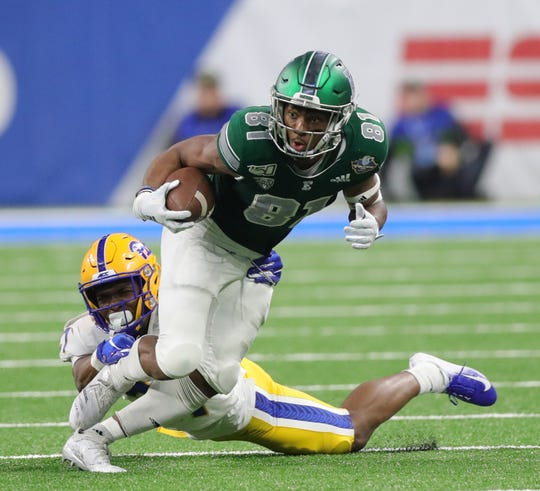 Eastern Michigan Eagles receiver Quian Williams makes a catch against Pittsburgh Panthers defensive back Damarri Mathis during the second half of the Quick Lane Bowl, Thursday, Dec. 26, 2019 at Ford Field in Detroit.