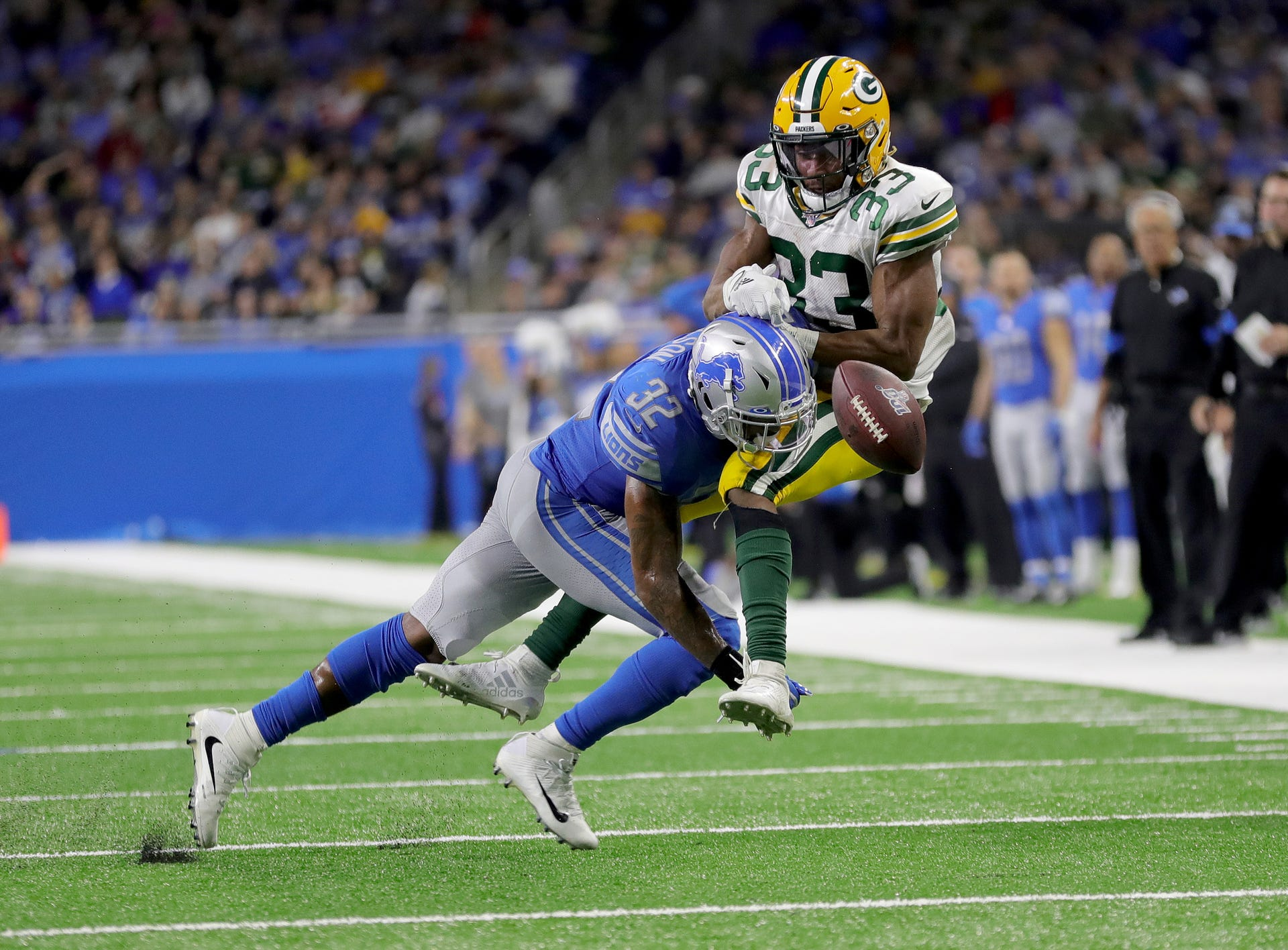 Detroit Lions safety Tavon Wilson breaks up a pass to Green Bay Packers running back Aaron Jones during the second half Sunday, Dec. 29, 2019 at Ford Field.