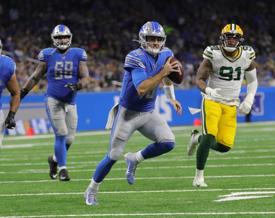 Detroit Lions quarterback David Blough runs vs. the Green Bay Packers during the first half Sunday, Dec. 29, 2019 at Ford Field.