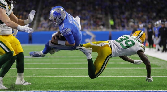 Detroit Lions quarterback David Blough is tackled short of the goal line by Green Bay Packers defensive back Chandon Sullivan (39) during the first half Sunday, Dec. 29, 2019 at Ford Field.