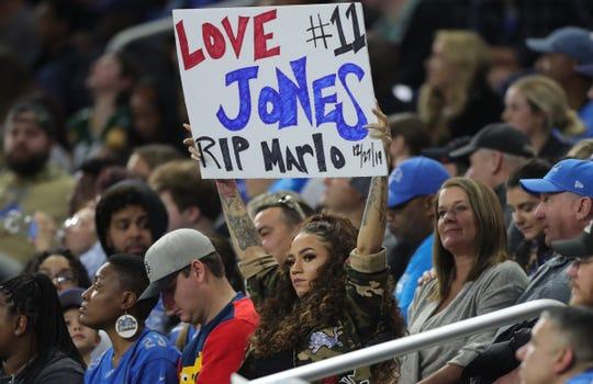 Jennifer Slay, wife of Detroit Lions cornerback Darius Slay, holds up a sign supporting receiver Marvin Jones, who infant son Marlo recently died, Sunday, Dec. 29, 2019 at Ford Field.