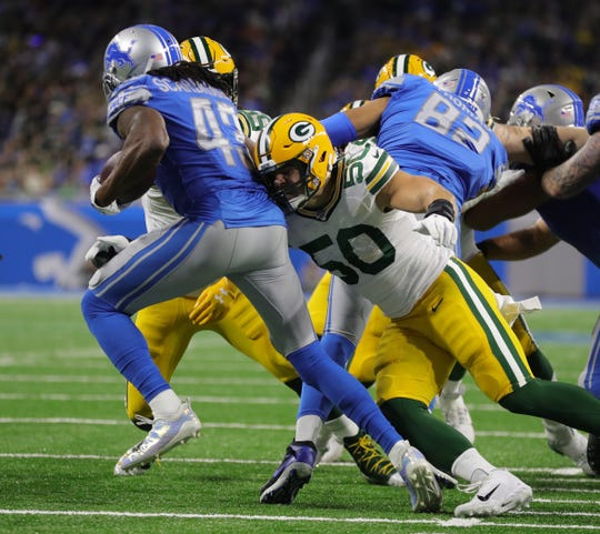 Detroit Lions running back Bo Scarbrough is tackled by Green Bay Packers linebacker Blake Martinez during the first half Sunday, Dec. 29, 2019 at Ford Field.