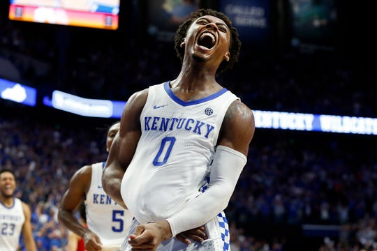 Kentucky's Ashton Hagans celebrates after an overtime win against Louisville Saturday in Lexington, Ky.