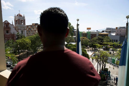 A Honduran man deported from the United States looks over the central park of San Pedro Sula, Honduras on Dec. 1, 2019.