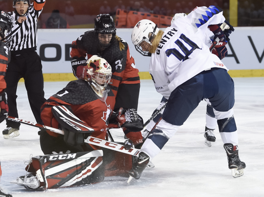 Alpena's Emma Gentry, right, is stopped in front of the Canada net during a 2-1 loss at the world U18 women's championship in Bratislava, Slovakia.