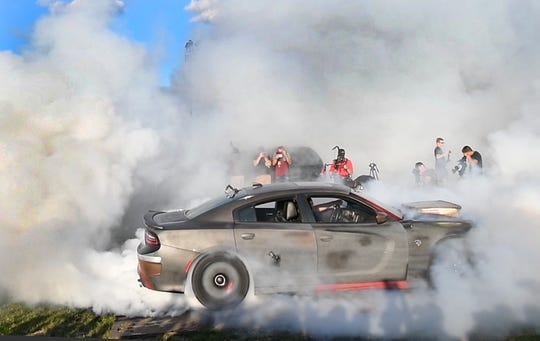 A Dodge Charger smokes its tires at last year's Roadkill Nights. The event has been canceled because of coronavirus concerns.