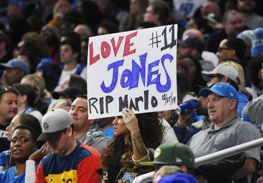 Lions' Darius Slays wife, Jennifer Slay, in the stands, holds up a sign in support of the Lions wide receiver Marvin Jones Jr. and his family after their infant son Marlo, died Friday.