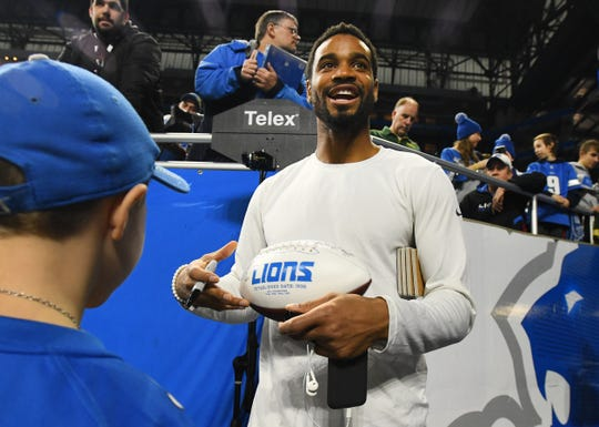 Lions cornerback Darius Slay signs an autograph before Sunday's regular-season finale.