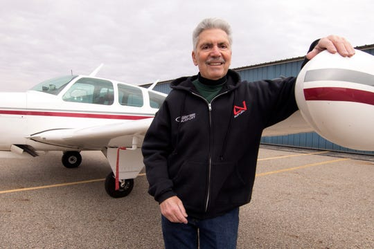 Mario Pecchia, an employee at the Spencer J. Hardy Airport in Howell, stands at the wing of a 1967 Beechcraft Bonanza owned by his friend Ray Blach on Dec. 13, 2019.