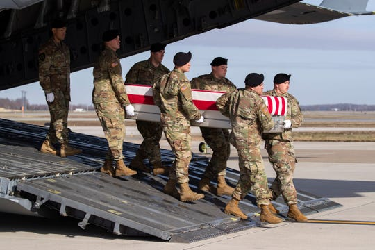 An Army carry team moves a transfer case containing the remains of U.S. Army Sgt. 1st Class Michael Goble, on Dec. 25 at Dover Air Force Base, Del..