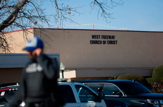 An officer walks near the scene after a church shooting at West Freeway Church of Christ on Sunday, Dec. 29, 2019 in White Settlement, Texas.