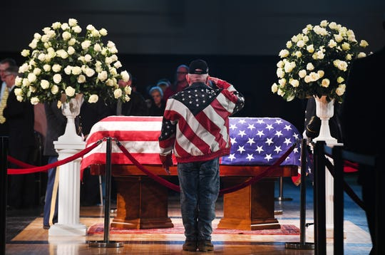 Friends, family and admirers file past the casket of retired Rep. John D. Dingell at the Ford Community and Performing Arts Center in Dearborn, Michigan on Feb. 8, 2019.