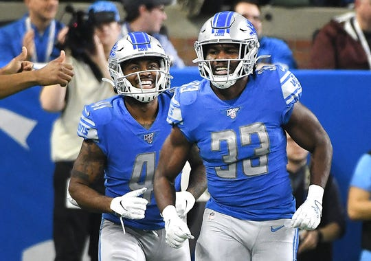 Lions running backs J.D. McKissic and Kerryon Johnson celebrate Johnson's touchdown run in the second quarter.