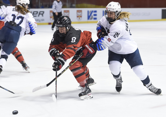 Okemos native Clara Van Wieren, right, battles for a loose puck during Sunday's 2-1 loss against Canada at the world women's U18 championship in Bratislava, Slovakia.
