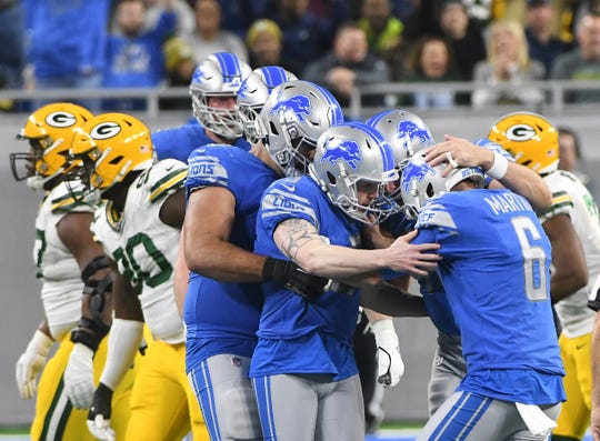 Lions players mob kicker Matt Prater after kicking a 50-yard field goal, passing former Lion Jason Hanson for  second most of 50+ or better.