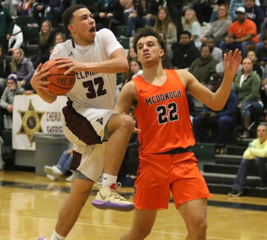 Elmira's Devin Dennard goes up for a shot as McDonogh's Preston Howard defends in a boys National Division quarterfinal at the Josh Palmer Fund Elmira Holiday Inn Classic on Dec. 28, 2019 at Elmira High School.
