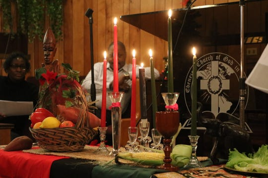 Among the traditional Kwanzaa festivities includes the lighting of seven candles, each representing one of the seven principles of Kwanzaa.