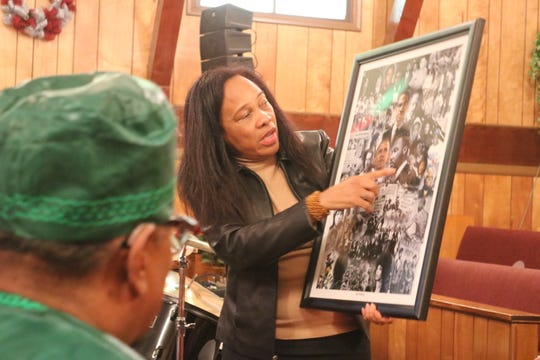 Fremont NAACP President Regina Vincent-Williams discusses various prominent African-American leaders, both past and present, during the Kwanzaa celebration on Saturday.