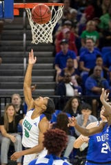 Davion Wingate, a guard for the FGCU Eagles, drives for a layup during the second half of the game against the Duke University. FGCU cruised to a victory after a 78-56 win Sunday afternoon, December 29,2019 at Alico Arena.