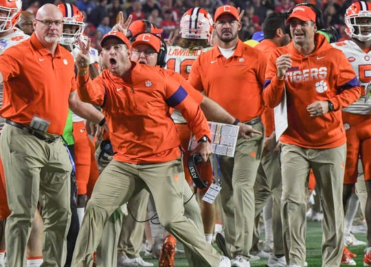 Clemson Head Coach Dabo Swinney signals for a two-point conversion attempt during the fourth quarter of the PlayStation Fiesta Bowl of the College Football Playoffs semi-final game, at State Farm Stadium in Glendale, Arizona Saturday, December 28, 2019.