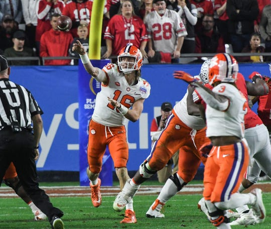 Clemson quarterback Trevor Lawrence (16) throws a pass against Ohio State during the fourth quarter of the PlayStation Fiesta Bowl of the College Football Playoffs semi-final game, at State Farm Stadium in Glendale, Arizona Saturday, December 28, 2019.