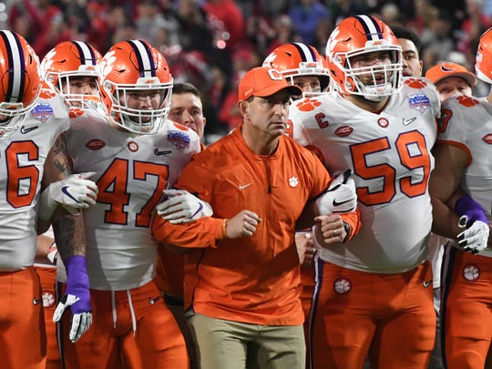Clemson Head Coach Dabo Swinney with linebacker James Skalski (47) and offensive lineman Gage Cervenka (59) in the Walk of Champions before the PlayStation Fiesta Bowl of the College Football Playoffs semi-final game, at State Farm Stadium in Glendale, Arizona Saturday, December 28, 2019.