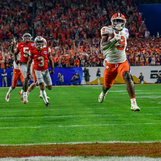 Clemson running back Travis Etienne (9) runs by Ohio State corner back Damon Arnette(3) for a touchdown during the second quarter of the PlayStation Fiesta Bowl of the College Football Playoffs semi-final game, at State Farm Stadium in Glendale, Arizona Saturday, December 28, 2019.