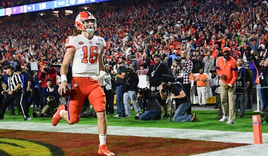 Clemson quarterback Trevor Lawrence (16) runs 67 yards for a touchdown against Ohio State during the second quarter of the PlayStation Fiesta Bowl of the College Football Playoffs semi-final game, at State Farm Stadium in Glendale, Arizona Saturday, December 28, 2019.