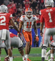 Clemson safety Isaiah Simmons (11) watches Ohio State quarterback Justin Fields(1) during the third quarter of the PlayStation Fiesta Bowl of the College Football Playoffs semi-final game, at State Farm Stadium in Glendale, Arizona Saturday, December 28, 2019.