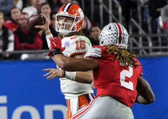 Clemson quarterback Trevor Lawrence (16) throws under the pressure of Ohio State defensive end Chase Young(2) during the fourth quarter of the PlayStation Fiesta Bowl of the College Football Playoffs semi-final game, at State Farm Stadium in Glendale, Arizona Saturday, December 28, 2019.