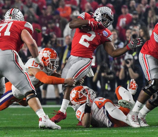 Clemson linebacker Jake Venables (15) tackles Ohio State running back J.K. Dobbins(2) during the first quarter of the of the PlayStation Fiesta Bowl of the College Football Playoffs semi-final game, at State Farm Stadium in Glendale, Arizona Saturday, December 28, 2019.