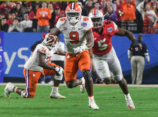 Clemson running back Travis Etienne (9) races for the end zone on a touchdown play during the third quarter of the PlayStation Fiesta Bowl of the College Football Playoffs semi-final game, at State Farm Stadium in Glendale, Arizona Saturday, December 28, 2019.