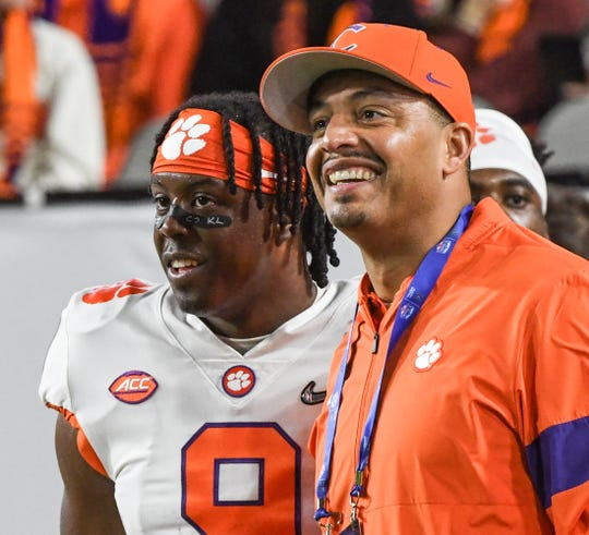 Clemson running back Travis Etienne (9) stands near co-offensive coordinator Tony Elliott before the PlayStation Fiesta Bowl of the College Football Playoffs semi-final game, at State Farm Stadium in Glendale, Arizona Saturday, December 28, 2019.