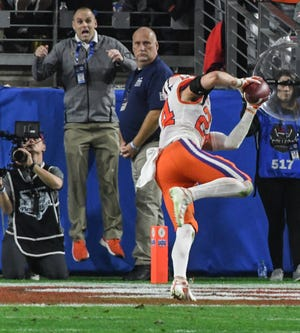 Clemson safety Nolan Turner (24) intercepts a pass from Ohio State quarterback Justin Fields(1) during the fourth quarter of the PlayStation Fiesta Bowl of the College Football Playoffs semi-final game, at State Farm Stadium in Glendale, Arizona Saturday, December 28, 2019.