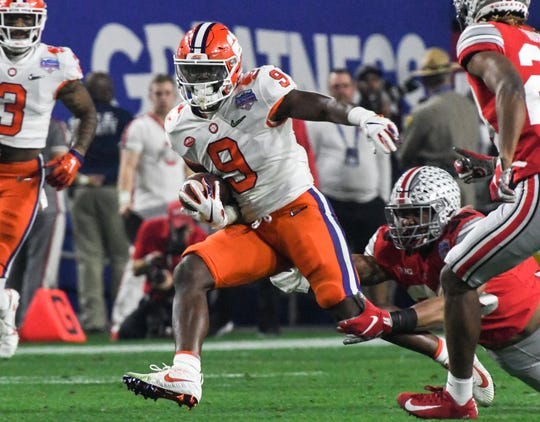 Clemson running back Travis Etienne (9) runs against Ohio State during the second quarter of the PlayStation Fiesta Bowl of the College Football Playoffs semi-final game, at State Farm Stadium in Glendale, Arizona Saturday, December 28, 2019.