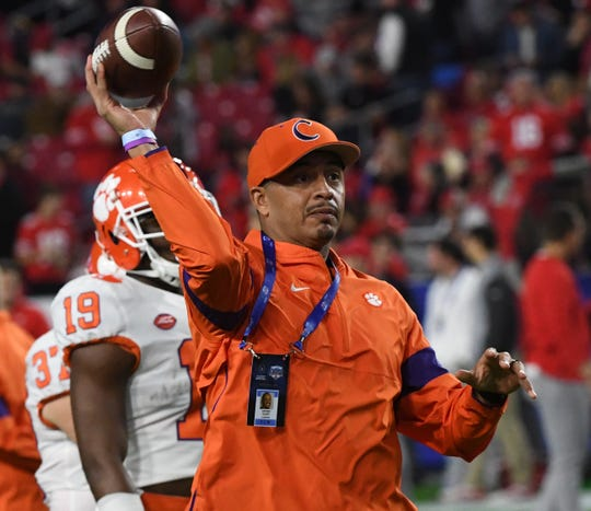 Clemson co-offensive coordinator Tony Elliott throws a ball during practice before the PlayStation Fiesta Bowl of the College Football Playoffs semi-final game, at State Farm Stadium in Glendale, Arizona Saturday, December 28, 2019.