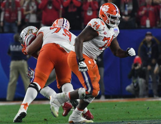 Clemson offensive lineman Jackson Carman (79) wraps up Ohio State defensive end Chase Young(2) on the play running back Travis Etienne (9) gets a touchdown during the third quarter of the PlayStation Fiesta Bowl of the College Football Playoffs semi-final game, at State Farm Stadium in Glendale, Arizona Saturday, December 28, 2019.
